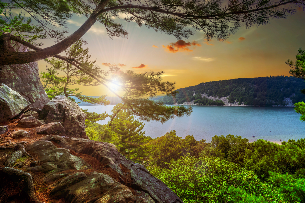 Join us for these many romantic things to do in Baraboo WI, including visiting the incredible Devils Lake State Park pictured here